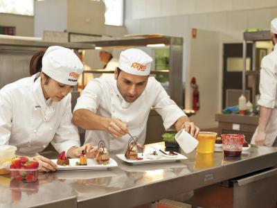 Students put the finishing touches to a dish. Photo credit: William Angliss Institute