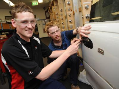 Learning how to repair and replace locks on cars.  Photo credit: NMIT.