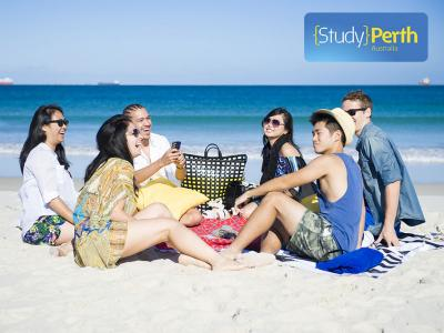 Students relaxing on the beach in Perth, Western Australia. Photo credit: Study Perth