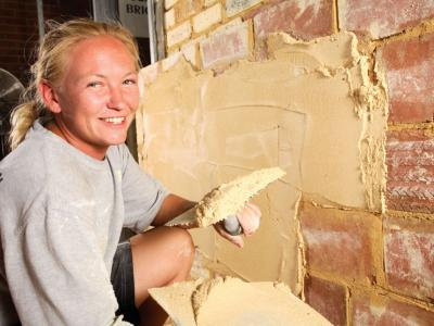 Train in trades like plastering.  Photo credit: Silver Trowel Training.