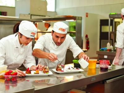 Students adding the finishing touches to some desserts. Photo credit: William Angliss Institute